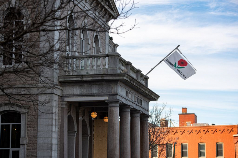 The flag of the Royal Canadian Legion flies at Town Hall